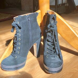 Used Juicy Couture high-ankle black suede booties.